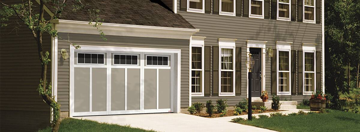Eastman E-12, 14' x 7',  Claystone doors and Ice White overlays, 4 lite Orion windows